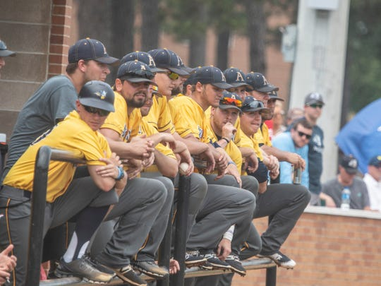 The Augustana baseball team watches from the dugout against Southern Arkansas.