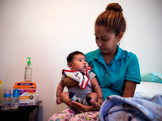 Destiny Martinez holds her son, Zachary Longoria, 2 months, in their apartment at the Rincon Point Apartments in Taft on Monday, May 21, 2018. A single mother of five, she said that the complex should have notified residents that the complex was facing foreclosure.