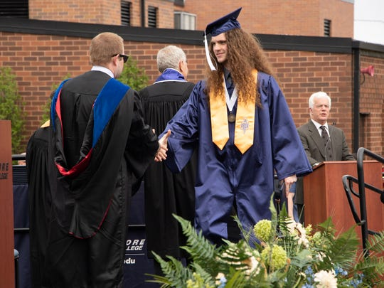 Jonathan Benfield accepts his diploma during Lakeshore Technical College's commencement ceremony May 19.