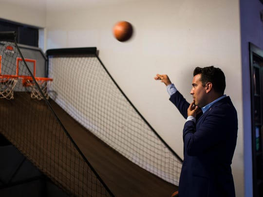 Eric Holguin, Democratic candidate in the District 27 congressional race, shoots a basketball while he waits for election results on Tuesday, May 22, 2018 at the Exchange.