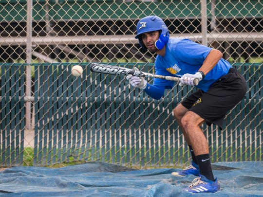 Texas A&M-Kingsville's  Alex Gonzalez works on butting at practice before they leave for the NCAA Division II World Series in North Carolina, Wednesday, May 23, 2018.