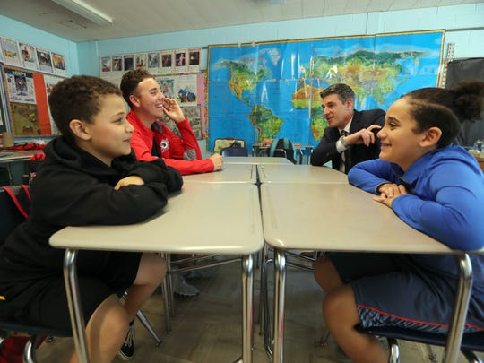 Nikolas Keeley, left, a fifth-grade student at Farley Elementary School in Stony Point, New York, John McElroy, a senior at North Rockland High School, Kris Felicello, assistant superintendent at North Rockland Central School District, and fifth-grader Christopher DeLeon, are part of a team created by the school district to examine how homework is assigned. The four met at Farley Elementary School on May 23, 2018.