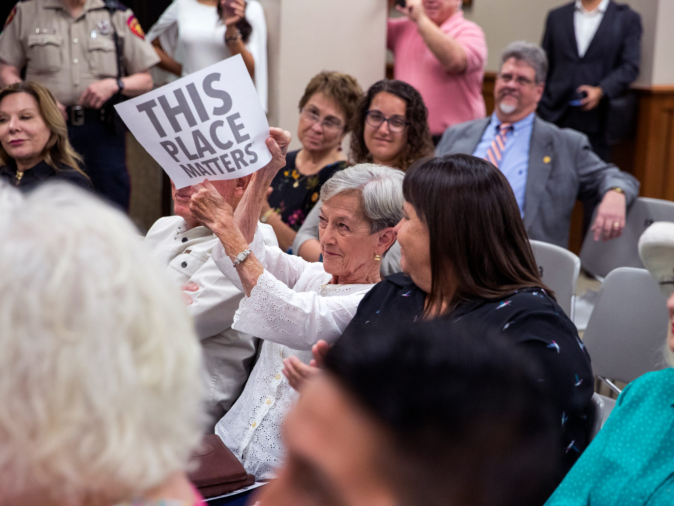 Corpus Christi resident Greer Mahaffey, 75, holds up