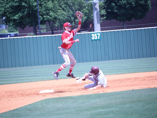 Rossview snags a the ball to tag out a Collierville