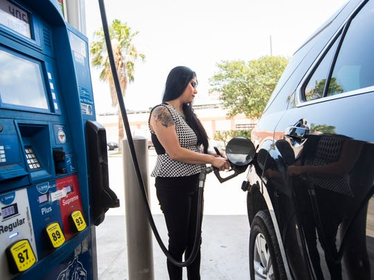 Krystal Gonzales fuels up her tank at an Exxon station