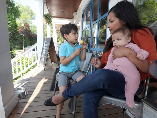 "Maria Colaco of Katonah with her children Thomas, 5, and Charlotte, three months outside the Katonah Reading Room May 25, 2018. Colaco spoke about raising a son in the ""Me Too"" era."