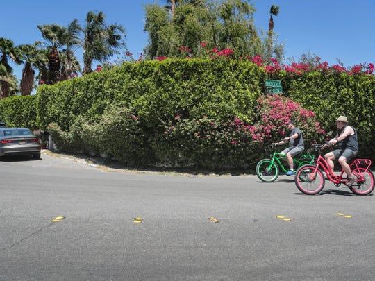 Two men on rental bikes in the Vista Las Palmas neighborhood in Palm Springs on Saturday, May 26, 2018.