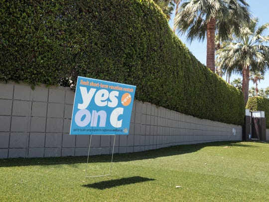 A yes to Measure C sign in front of a house in the