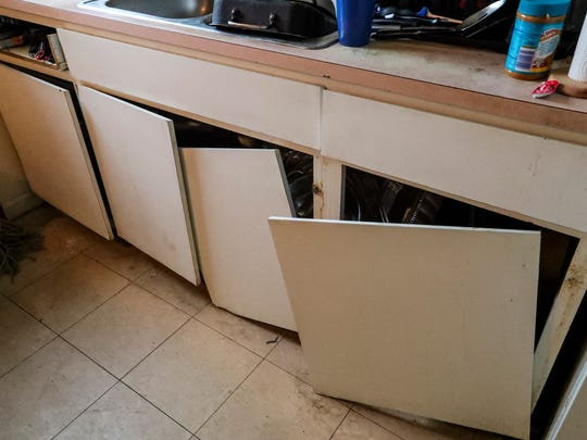The doors are falling off the failing kitchen cabinets at Fort Myers' Jones Walker apartments. Tenants say the complex is unsafe, with falling ceilings, mold and roaches due to long-deferred maintenance.