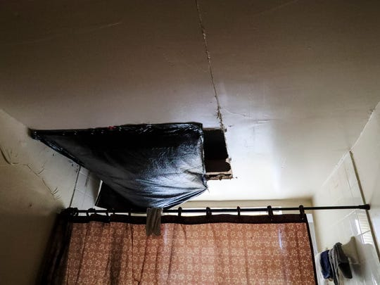 A hole in a bathroom ceiling is covered by a black trash bag. It has been this way for weeks. Fort Myers' Jones Walker is endangering its tenants with falling ceilings, mold and roaches and more due current and past owners' neglect.