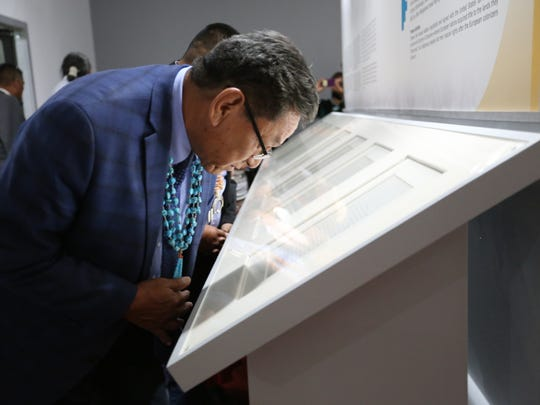 Navajo Nation President Russell Begaye looks at beginning pages of the original Treaty of 1868 that is on display at the Navajo Nation Museum for the month of June 2018.