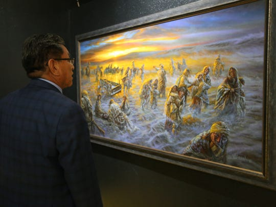 Navajo Nation President Russell Begaye looks at a painting titled 'Hwéeldi' by James King from Shiprock on May 31, 2018. The painting is part of the exhibit at the Navajo Nation Museum.