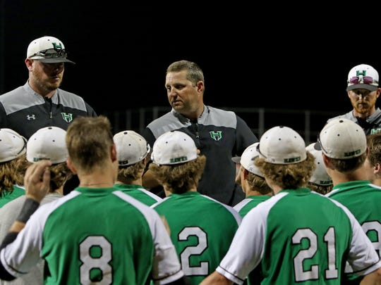 Iowa Park head baseball coach Michael Swenson talks to his team after the Hawks 9-5 loss to Godley in Game 3 of the Region I-4A finals Friday, June 1, 2018, at Northwest High School in Justin.