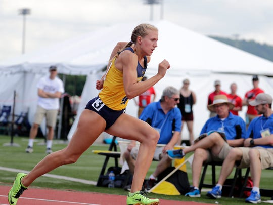 Brooke Jaworski of Wausau West runs the fastest time in qualifying for the girls Division 1 400 meters Friday. Jaworkski also set a state record in the the 300 hurdles during her qualifying heat.