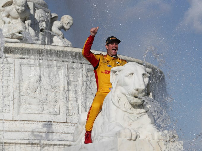 Ryan Hunter-Reay sits on a marble lion in the James