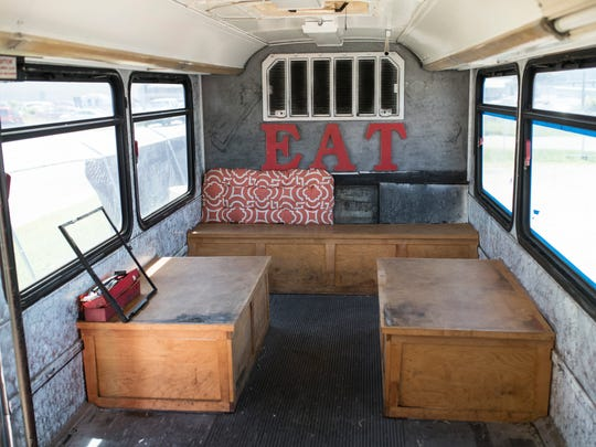 Inside a former airport transport bus that has been