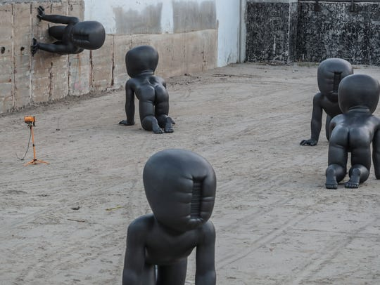 A cluster of baby statues titled Babies by artist David