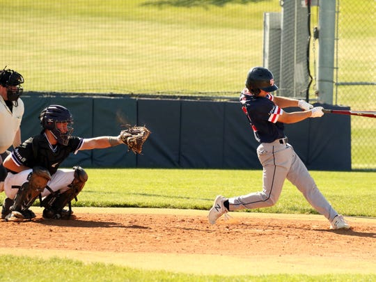 John Rogers of SF West fouls off a pitch in front of