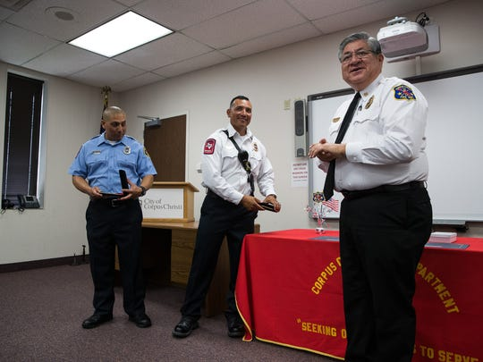 Corpus Christi Fire Chief Robert Rocha (right) awards Battalion Chief Juan Tony Perez (center) and Firefighter II EMS Michael Macias the life-saving award during a ceremony on Wednesday, June 6, 2018.