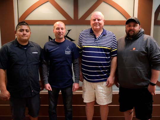 Andrew Jordan, chef at Milwaukee Burger Company; Ryan Kraft, mayor of Seymour; Bob Nelson, member of Chefs Gone Grilling competitive barbecue team; and Bob Stahl, owner of ZZQ's and ZoZo's Kitchen, scored the burgers for originality, texture and flavor.