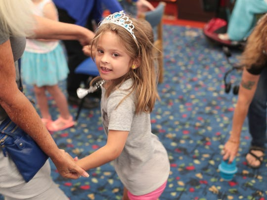 Kennedy Gerber, 4, dances during Drag Queen Story Hour
