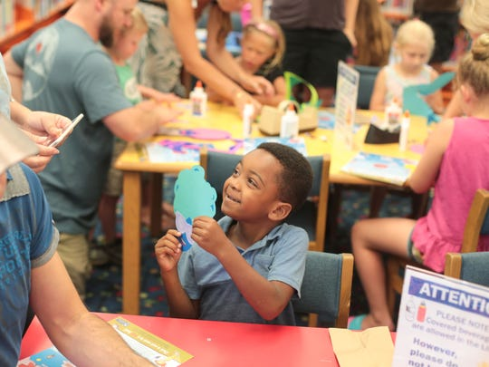 Xyler Pamos-King (CQ, 5,) shows his Bella da Ball puppet at the Palm Springs Library's second Drag Queen Story Hour on Wednesday, June 6, 2018.