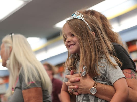 Kennedy Gerber, 4, enjoys story time at Drag Queen