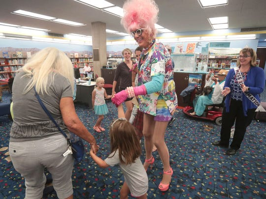 Bella da Ball leads a dance circle at the Palm Springs Library's second Drag Queen Story Hour on Wednesday, June 6, 2018.