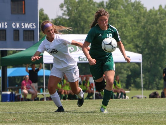Pella's Grace Held (19) chases down the ball during the girls' Class 2A state soccer semifinals at the Cownie Soccer Complex on June 8, 2018.