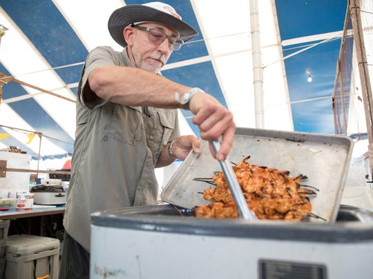 Ken Williams places cajun shrimp in the warmer during the 70th annual Shrimporee in Aransas Pass on Saturday, June 9, 2018.