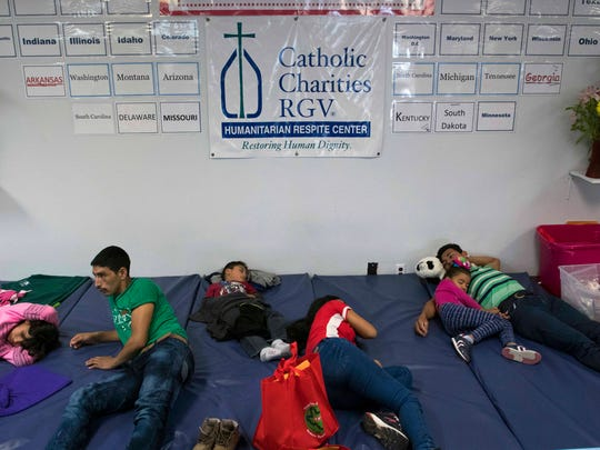Families sleep on a padded mat after being released by U.S. Immigration officials at the Catholic Charities Rio Grande Valley refugee center.