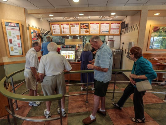 Sun City residents order food at the Wendy's in Palm