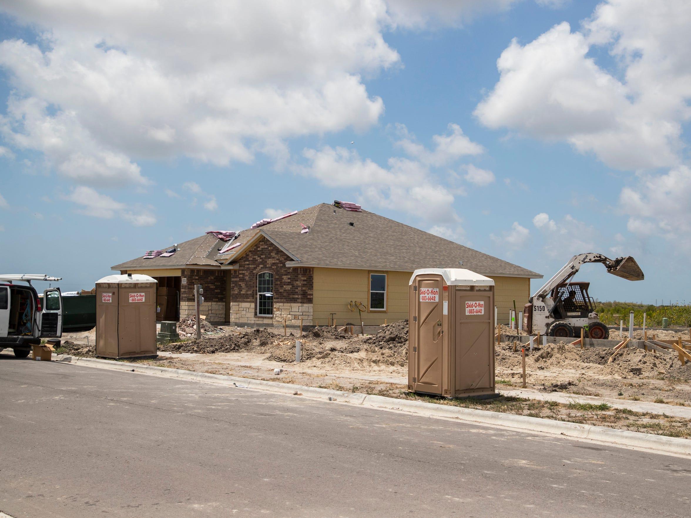 New houses sit under construction near Yorktown Boulevard