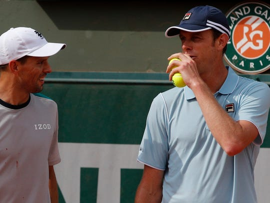 Mike Bryan, left, and Sam Querrey take a moment to