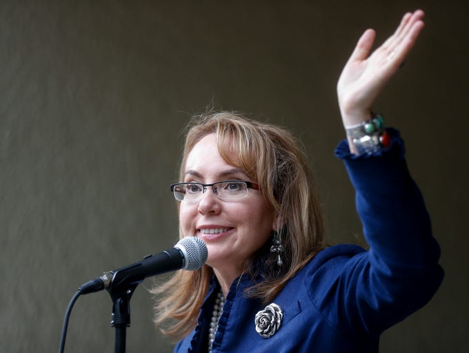 Former U.S. Rep. Gabby Giffords waves to supporters