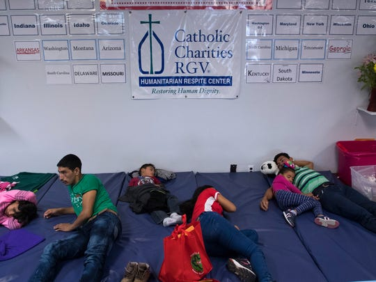 Families sleep on padded mats after being released by U.S. Immigration officials at the Catholic Charities Rio Grand Valley refugee center in McAllen.