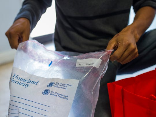 A man checks a bag with his belongings after being released by U.S. Immigration officials on Thursday, May 7, 2018, at the Catholic Charities Rio Grande Valley refugee center in McAllen, Texas. (Casey Jackson/Corpus Christi Caller-Times)