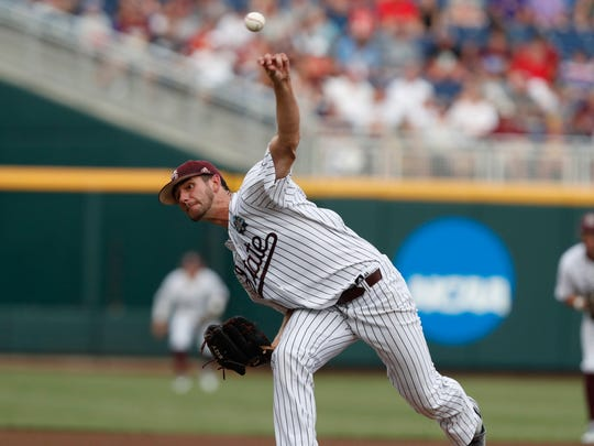 Jun 16, 2018; Omaha, NE, USA; Mississippi  State Bulldogs pitcher Ethan Small (44) throws against the Washington Huskies in the first inning during the College World Series at TD Ameritrade Park. Mandatory Credit: Bruce Thorson-USA TODAY Sports