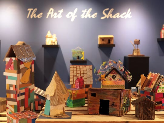 A collection of model shacks on display at La Quinta