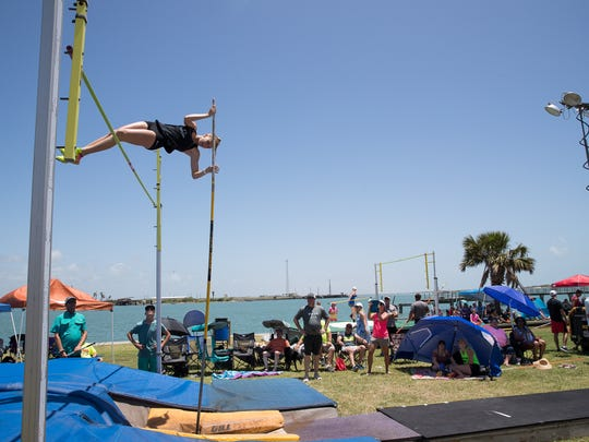 Pole vaulters compete in the Port Aransas Beach Vault at Roberts Point Park on Saturday, June 16, 2018.