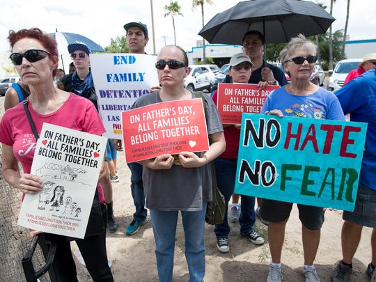 People gather for a vigil on Fathers Day outside Border Patrol Processing Center in McAllen on Sunday, June 17, 2018. They called for the end of the practice of separating immigrant children brought into the country illegally from their parents.