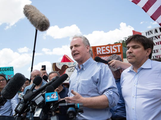 At left, U.S. Sen. Chris Van Hollen, of Maryland, gives a statement outside the Border Patrol Processing Center in McAllen on Sunday, June 17, 2018. He and other lawmakers spoke out on the practice of separating immigrant children brought into the country illegally from their parents.
