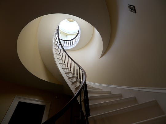The Greek Revival home features this spiral staircase