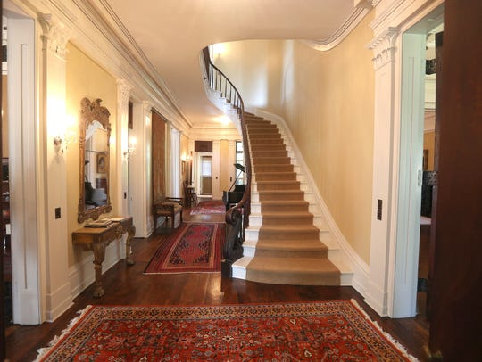 A majestic view of the front hallway near the main