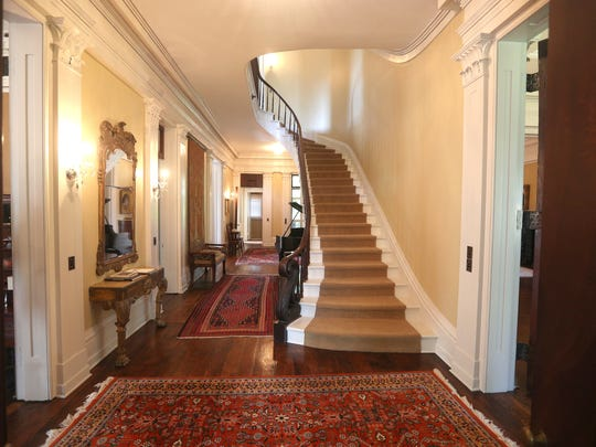 A majestic view of the front hallway near the main entrance.