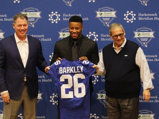 Giants head coach Pat Shurmur with first round draft pick for the Giants, Saquon Barkley and Giants general manager David Gettleman introducing Barkley to the media before his press conference.