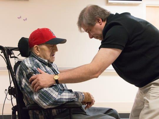 Nick Bonanno visits his father, WWII veteran Russ Bonanno, at the VA nursing home in Bedford, Mass.