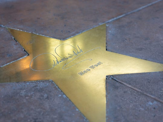 The names and signatures of celebrities who have stayed at Hotel San Carlos are etched onto golden stars that line the sidewalks of the building.
