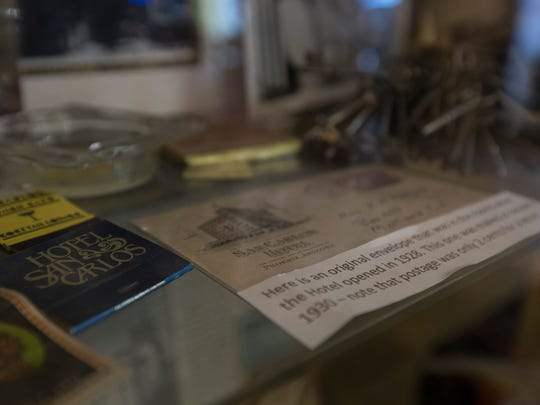 The Melikian family and workers of the Hotel San Carlos keep old postcards and trinkets from over the years in a glass case in the lobby.