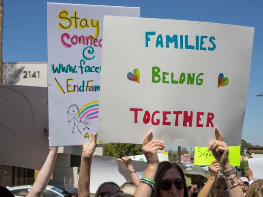 immigrant children family separation protest outside mccain flake phoenix office